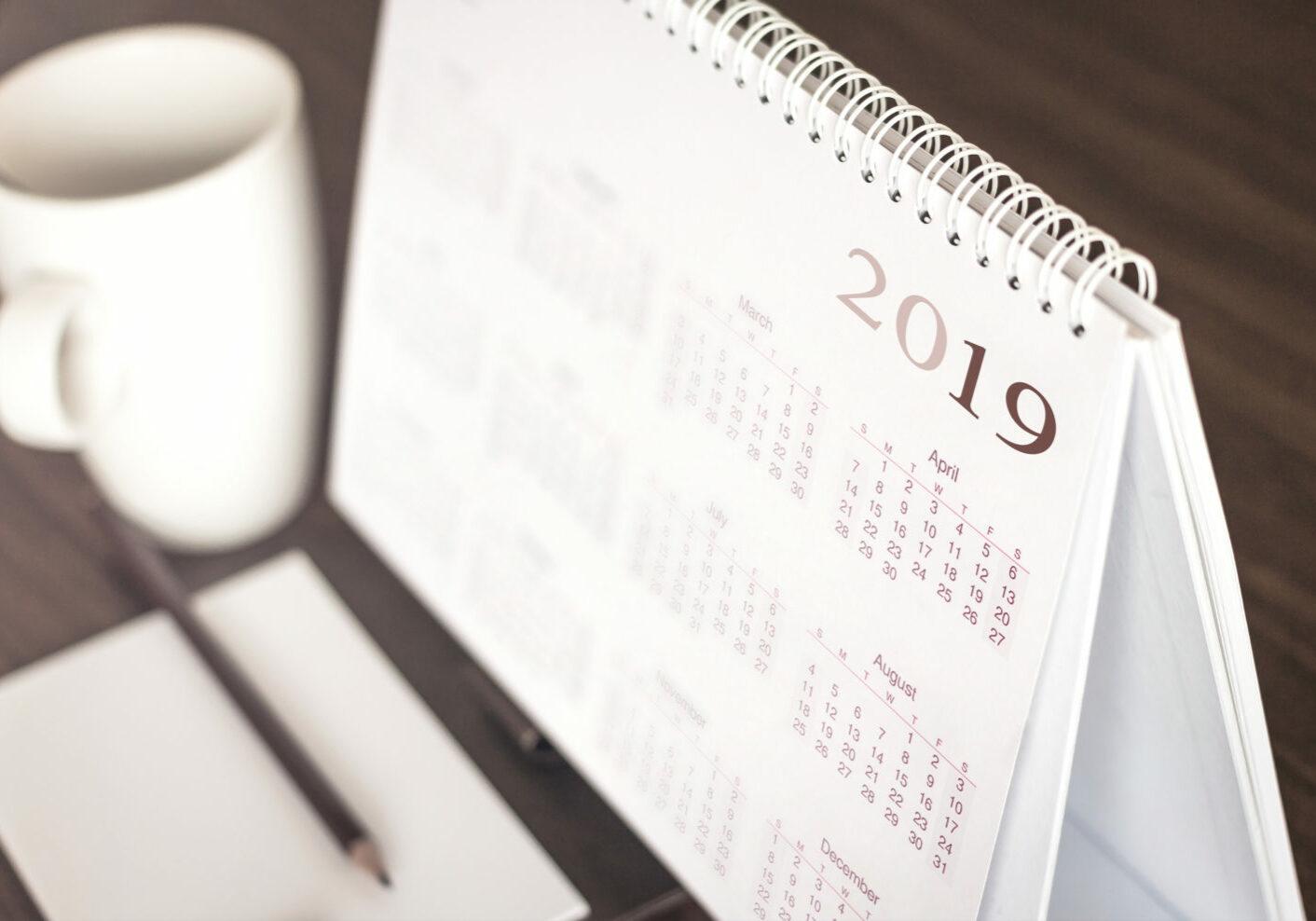 Desktop calendar sitting on desk showing year of 2019